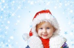 Niña en sombrero de la Navidad Foto de archivo