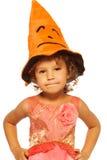 Niña en sombrero del traje de Halloween Imagenes de archivo