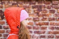 Niña en sombrero y chaqueta rosados Imagen de archivo libre de regalías