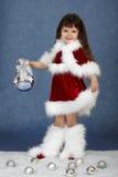 Niña en traje de la Navidad con la bola de cristal Imagen de archivo libre de regalías