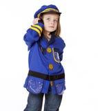 Niña en traje de la policía Imagen de archivo
