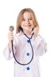 Niña en traje del doctor Imagen de archivo