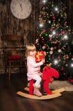 Niña en un caballo del juguete Fotos de archivo libres de regalías