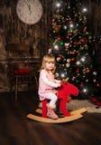 Niña en un caballo del juguete Fotografía de archivo libre de regalías