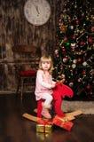 Niña en un caballo del juguete Imagen de archivo libre de regalías
