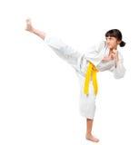Niña en un kimono con un marco amarillo Fotografía de archivo libre de regalías