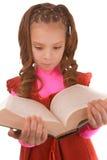 Niña en vestido rojo y con el libro Imagen de archivo libre de regalías