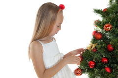 Niña feliz con el árbol de navidad Fotografía de archivo