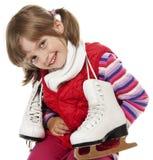 Niña feliz con los patines de hielo Foto de archivo