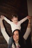 Niña feliz y su madre fotografía de archivo libre de regalías