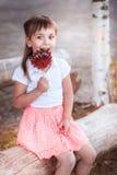 Niña hermosa con el caramelo Imagenes de archivo