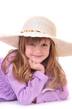 Niña hermosa con el pelo largo y un sombrero encendido Fotografía de archivo libre de regalías