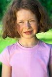 Niña hermosa con el pelo rizado Imágenes de archivo libres de regalías