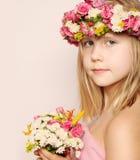 Niña hermosa con las flores Imagen de archivo