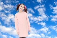 Niña hermosa en un vestido rosado Fotos de archivo