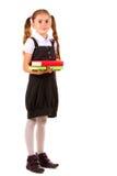 Niña hermosa en uniforme escolar y libros Imágenes de archivo libres de regalías