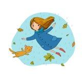 Niña hermosa y un vuelo lindo del gato de la historieta con las hojas de otoño stock de ilustración