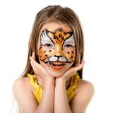 Niña linda con la cara pintada Foto de archivo libre de regalías