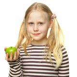 Niña linda con la manzana Imagen de archivo