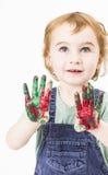 Niña linda con la pintura del finger que mira para arriba foto de archivo libre de regalías