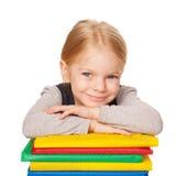 Niña linda con los libros. Retrato de la escuela. Fotos de archivo