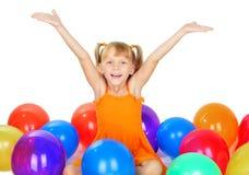 Niña linda divertida con los baloons Foto de archivo libre de regalías