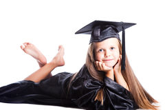 Niña linda en alineada de la graduación en blanco Imagen de archivo