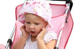 Niña linda en carro de bebé Imágenes de archivo libres de regalías