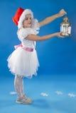 Niña linda en el sombrero de Claus Imagen de archivo