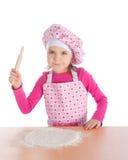 Niña que cocina la pizza Fotos de archivo libres de regalías