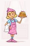 Niña que cocina la torta dulce en la cocina Foto de archivo libre de regalías