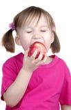 Niña que come la manzana Imágenes de archivo libres de regalías