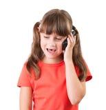 Niña que habla en el teléfono Foto de archivo libre de regalías