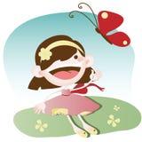 Niña que juega con la mariposa Foto de archivo
