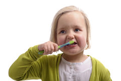 Niña que se lava los dientes Imágenes de archivo libres de regalías