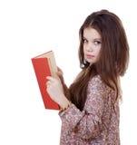 Niña que sostiene el libro rojo Foto de archivo libre de regalías