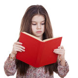 Niña que sostiene el libro rojo Fotografía de archivo libre de regalías