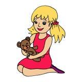 Niña que sostiene el oso de peluche Imagen de archivo libre de regalías