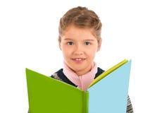 Niña que sostiene un libro de la historia verde y azul imagen de archivo libre de regalías