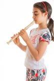 Niña que toca la flauta fotos de archivo libres de regalías