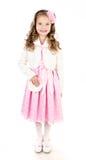 Niña sonriente adorable en el vestido rosado de la princesa aislado imagen de archivo