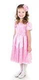 Niña sonriente adorable en el vestido rosado de la princesa aislado Imagen de archivo libre de regalías