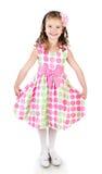Niña sonriente adorable en vestido rosado de la princesa Fotografía de archivo libre de regalías
