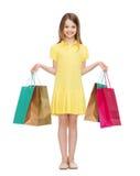 Niña sonriente en vestido con los panieres Foto de archivo libre de regalías