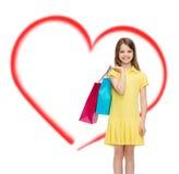 Niña sonriente en vestido con los panieres Imagen de archivo libre de regalías