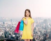 Niña sonriente en vestido con los panieres Fotografía de archivo libre de regalías
