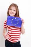 Niña y bandera europea Imagenes de archivo