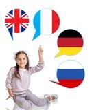 Niña y burbujas con las banderas de países Imagen de archivo