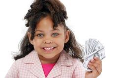 Niña y dinero adorables fotografía de archivo