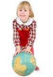 Niña y globo terrestre Fotos de archivo